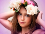 child with flowers in her hair