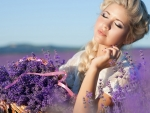 Beautiful blonde with a basket of lavender flowers