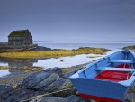 row boat on rocks in nova scotia