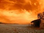 abandoned shack under orange sky