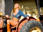 Cowgirl On A Tractor