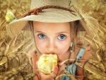 Young Cowgirl Eating an Apple