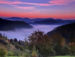 sunrise over a misty valley in autumn hdr