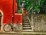 bicycle leaning on a red house hdr