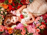 redhead surrounded by flowers