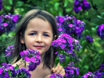 Just a little girl in the flowers