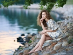 Beautiful girl on the shore of lake