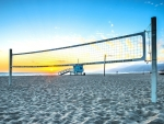 beach volleyball court at sunset