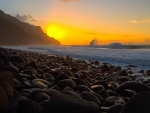 stones on kalalua bay at sunset
