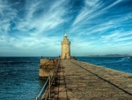 lighthouse on a stone pier hdr