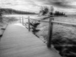 bridge to a an island in a lake in grayscale hdr
