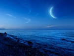 moon over gravel beach