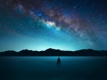 solitary sailboat under stary night