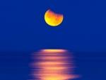 orange moon in blue sky