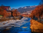 a river through a romanian town in winter hdr