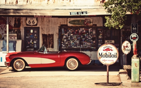 classic corvette in a garage on route 66 - converible, garage, signs, car