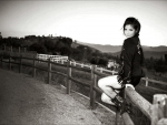 Cowgirl On The Fence