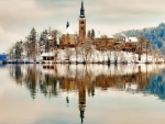 church on an isle in lake bled slovenia in winter