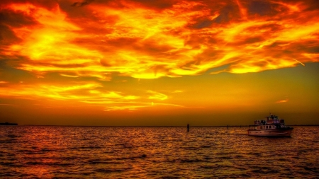 Fishing Boat Returning At Golden Sunset Hdr