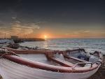 boat on a seashore at sunset hdr