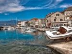 boat harbor in a town on brac island croatia