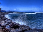 waves crashing a rocky shore hdr