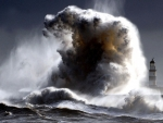 mighty wave crashing an offshore lighthouse