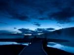 pier between sand bars at dusk