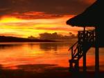 tropical hut at sunset