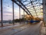 tram on a bridge in long exposure hdr
