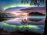 Northern Lights Over a Misty Lake