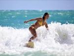 Girl Surfing in a Yellow Bikini