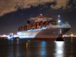 container ship docking at night