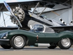 1957 Jaguar XK beside a Biplane