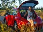 Model Posing on a VW Bug
