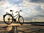 bicycle on a waterfront wooden ramp