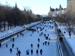 people skating on a frozen rideau canal in ottowa