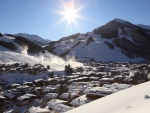 sunshine over a ski resort town in austria