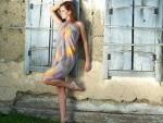 beautiful girl leaning on a barn