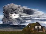 volcano erupting above a rural cabin