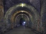 pedestrian tunnel covered in graffiti hdr