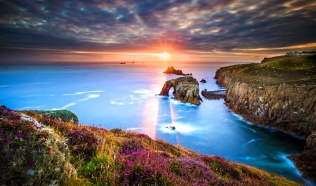 Lands end-Cornwall - rocks, glow, shore, beautiful, sunset, clouds, su rise, Cornwall, wildflowers, land, reflection, view, ocean, sky, water, rays, end, coast