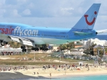 boeing 747 landing at princess juliana airport in st martin