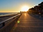 city beach walkway at sunset