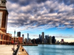 beautiful clouds above a city waterfront hdr