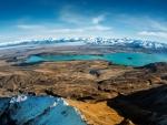 turquoise lake under huge mountain range