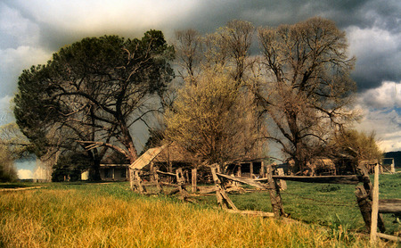 Stormy Skies - building, farm, dry tall grass, fields, fencing, trees, stormy skies