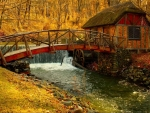 bridge to a small mill in autumn