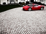 ferrari458 italia in a cobblestone driveway