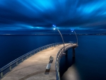 illuminated pier over steel blue water  hdr
